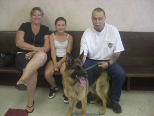 Zoey, a rescued German Shepherd, with her loving family. We're so happy we were able to find her a great home!